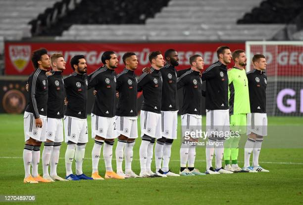 Players of Germany participate in the German national anthem prior to the UEFA Nations League group stage match between Germany and Spain at...