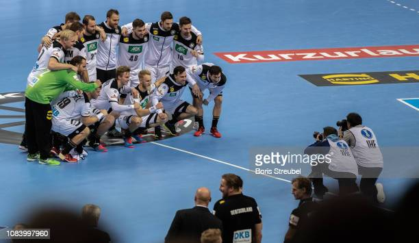 Players of Germany pose for a picture to celebrate their victory during the 26th IHF Men's World Championship group A match between Germany and...