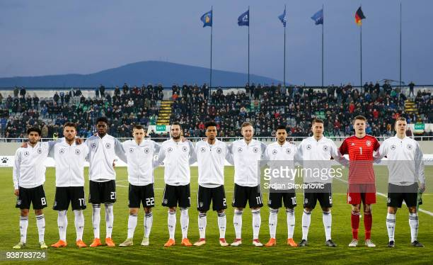 Players of Germany sing national anthem prior to the 2019 UEFA Under21 European Championship qualifier match between Kosovo U21 and Germany U21 at...