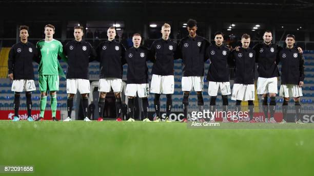 Players of Germany stand during their national anthem prior to the UEFA Under21 Euro 2019 Qualifier match between Azerbaijan U21 and Germany U21 at...