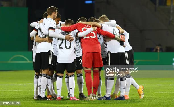 Players of Germany stand together prior to the international friendly match between Germany U21 and Slovenia U21 at Eintracht-Stadion on November 12,...