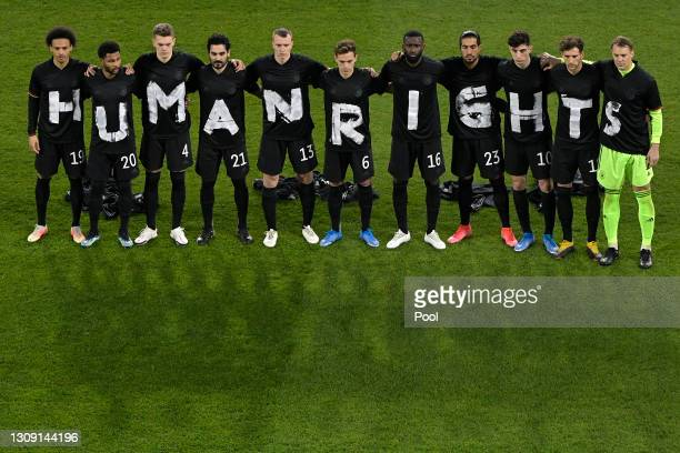 "Players of Germany wear t-shirts which spell out ""Human Rights"" prior to the FIFA World Cup 2022 Qatar qualifying match between Germany and Iceland..."