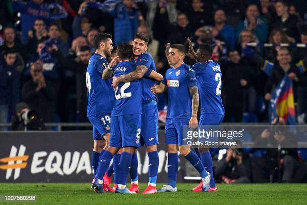 Players of Getafe CF celebrates after Kenedy scored his team's second goal during the UEFA Europa League round of 32 first leg match between Getafe...