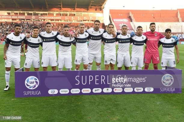 Players of Gimnasia line up for the team photo prior to a match between Lanus and Gimnasia y Esgrima La Plata as part of Super Liga 2019/20 at...