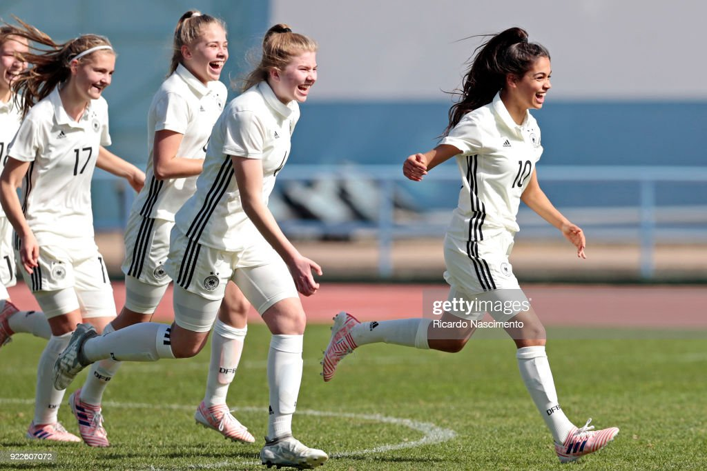 Players of Girls Germany U16 (L-R) Bente Fischer, Kim-Sophie Baade, Lina Vianden, Sonja Merazguia celebrate their vitory at the end of the final penalties during UEFA Development Tournament match between U16 Girls Germany and U16 Girls Italy at VRSA Stadium on February 19, 2018 in Vila Real de Santo Antonio, Portugal.