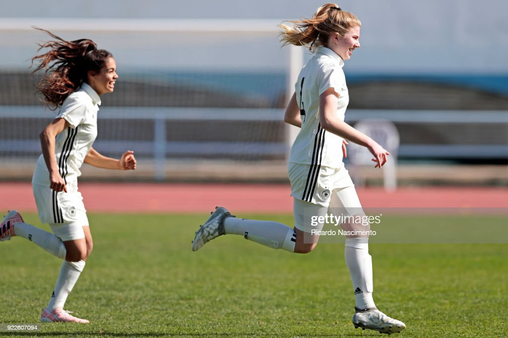 Players of Girls Germany U16 Sonja Merazguia (L) and Lina Vianden (R) celebrate their vitory at the end of the final penalties during UEFA Development Tournament match between U16 Girls Germany and U16 Girls Italy at VRSA Stadium on February 19, 2018 in Vila Real de Santo Antonio, Portugal.