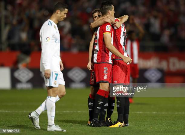 Players of Girona celebrate after the La Liga match between Girona and Real Madrid at Estadi de Montilivi on October 29 2017 in Girona Spain