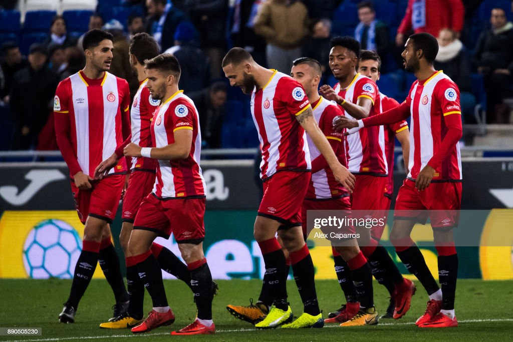 Players of Girona FC celebrate after their teammate David Timor scored the opening goal during the La Liga match between RCD Espanyol and Girona FC at RCDE Stadium on December 11, 2017 in Barcelona, Spain.