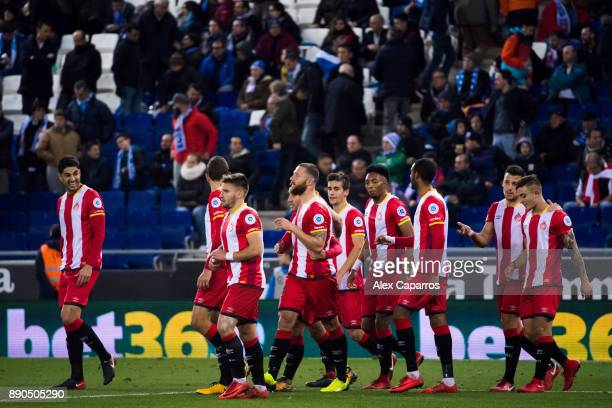 Players of Girona FC celebrate after their teammate David Timor scored the opening goal during the La Liga match between RCD Espanyol and Girona FC...