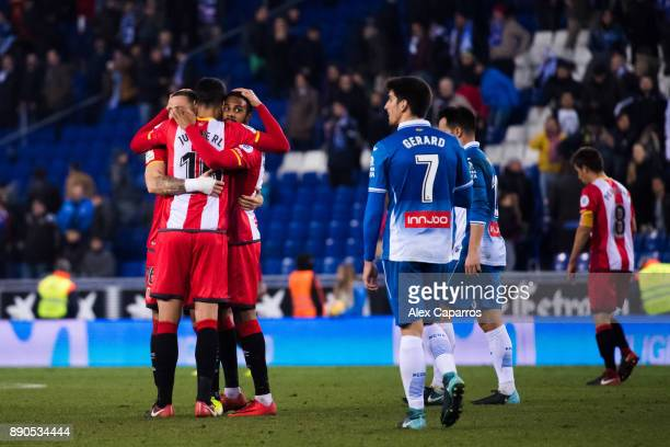 Players of Girona FC celebrate their victory after the La Liga match between RCD Espanyol and Girona FC at RCDE Stadium on December 11 2017 in...