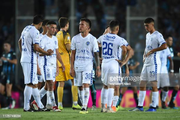 Players of Godoy Cruz leave the field after losing a match against Racing Club at Juan Domingo Peron Stadium on February 18 2019 in Avellaneda...