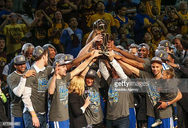 Players of Golden State Warriors celebrate their winning over the Cavaliers and win the NBA Championship Trophy in Cleveland on June 16 2015 The...