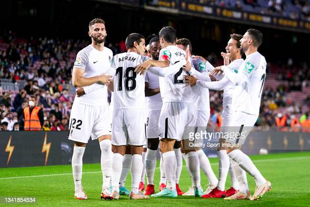 Players of Granada CF celebrating their team's first goal during the La Liga Santander match between FC Barcelona and Granada CF at Camp Nou on...