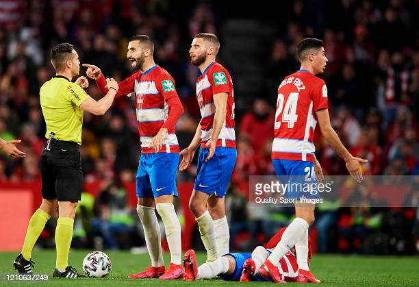 Players of Granada react with referee during the Copa del Rey Semi Final second leg match between Granada CF and Athletic Club at Nuevo Los Carmenes...
