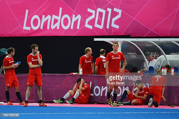 Players of Great Britain look dejected after their defeat against Australia in the Men's Hockey bronze medal match on Day 15 of the London 2012...