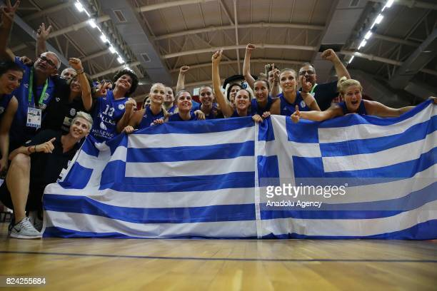 Players of Greece celebrate their championship after the Women's basketball final match between Greece and Lithuania within the 23rd Summer...