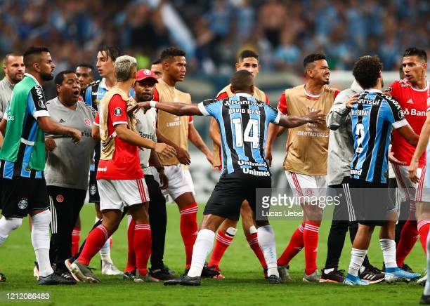 Players of Gremio and of Internacional argue during the match for the Copa CONMEBOL Libertadores 2020 at Arena do Gremio on March 12 2020 in Porto...