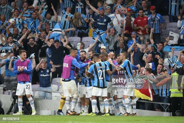 Players of Gremio celebrate after scoring a goal during the 2017 FIFA Club World Cup semifinal soccer match between Gremio and Pachuca at Hazza Bin...