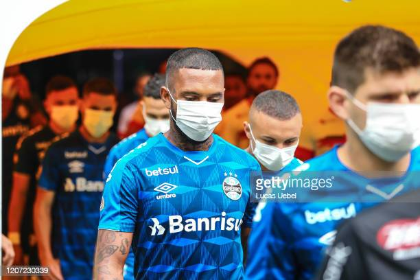 Players of Gremio enter the field wearing masks before the match between Gremio and Sao Luiz as part of the Rio Grande do Sul State Championship 2020...