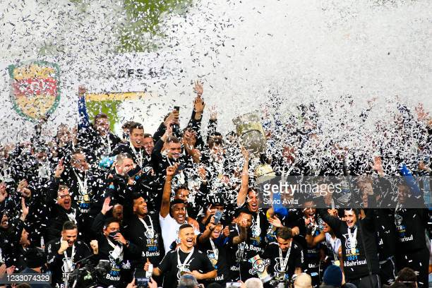 Players of Gremio lift the champions trophy after winning the final of Rio Grande Do Sul State Championship 2021 between Gremio and Internacional at...