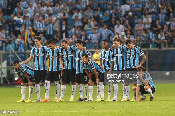 Players of Gremio looke dejected after loose the match between Gremio v San Lorenzo as part of round of sixteen of Copa Bridgestone Libertadores 2014...