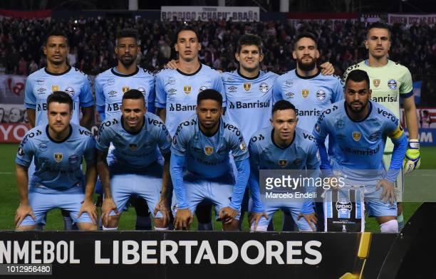Players of Gremio pose for a photo prior to the first round of sixteen first leg match between Estudiantes de La Plata and Gremio as part of Copa...