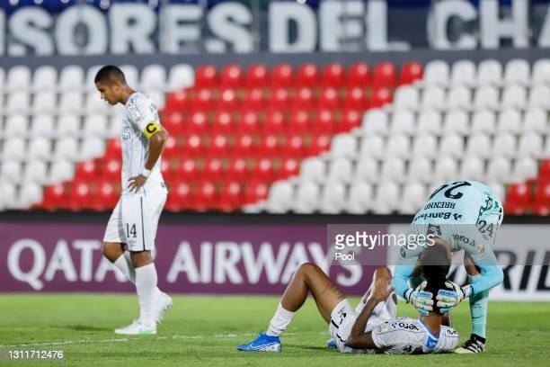 Players of Gremio react after a defeat in a third round first leg match between Independiente del Valle and Gremio as part of Copa CONMBEOL...
