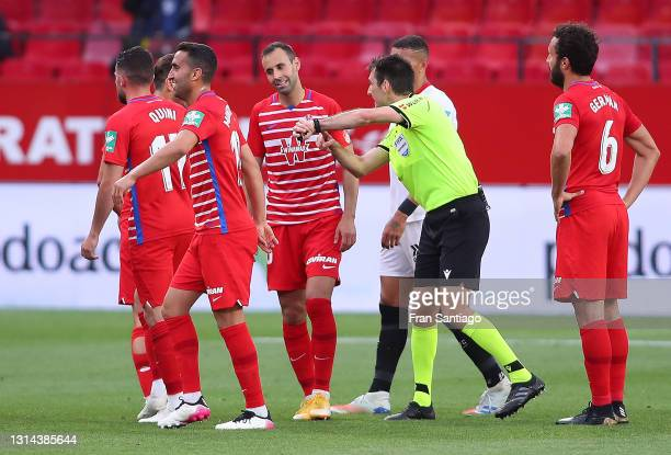 Players of Grenada FC protest as the referee only plays one of the four minutes added time during the La Liga Santander match between Sevilla FC and...