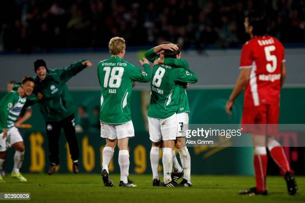 Players of Greuther Fuerth celebrates as Serdar Tasci of Stuttgart reacts after the DFB Cup match between SpVgg Greuther Fuerth and VfB Stuttgart at...