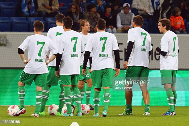 Players of Greuther Fuerth have name and number of Hoffenheim's badly injured player Boris Vukcevic on their jersey prior to the Bundesliga match...