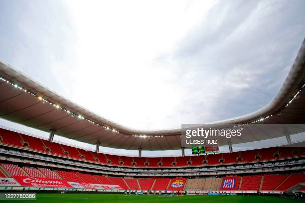 Players of Guadalajara and Leon keep a minute of silence for the people who died from COVID-19 and for the medical personnel before the beginning of...