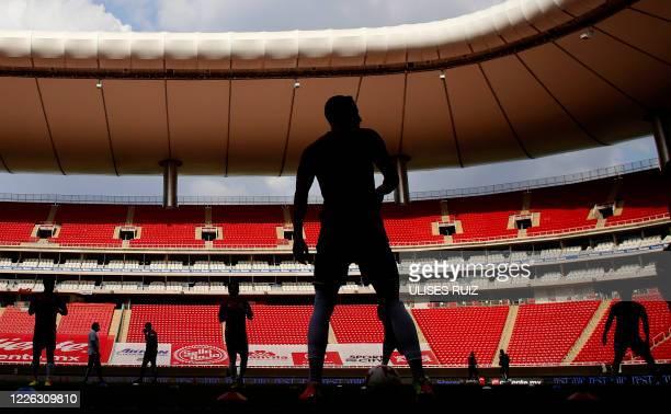 Players of Guadalajara warm up before the pre-season Copa por Mexico football tournament match against Mazatlan, at the Akron stadium in Zapopan,...