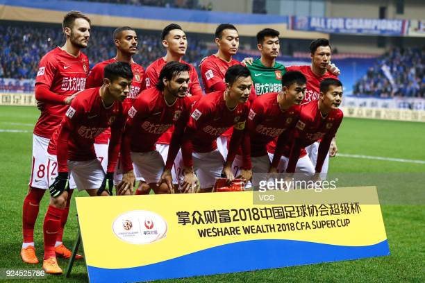 Players of Guangzhou Evergrande line up prior to the 2018 Chinese Football Association Super Cup between Shanghai Shenhua and Guangzhou Evergrande at...