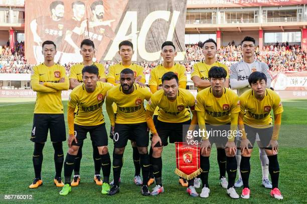 Players of Guangzhou Evergrande line up prior to the Chinese Super League match between Hebei China Fortune and Guangzhou Evergrande at Qinhuangdao...