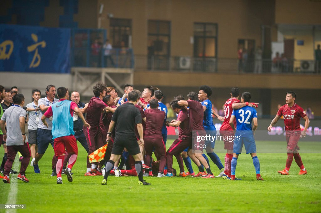 Players of Guangzhou R&F argue with Players of Shanghai SIPG as Shanghai's Oscar lies on the ground during the 13th round match of 2017 Chinese Football Association Super League (CSL) between Guangzhou R&F and Shanghai SIPG at Yuexiushan Stadium on June 18, 2017 in Guangzhou, China.