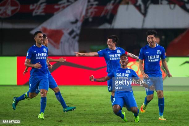 Players of Guangzhou RF celebrate a point during the 4th round match of China Super League between Guangzhou Evergrande and Guangzhou RF at Guangzhou...