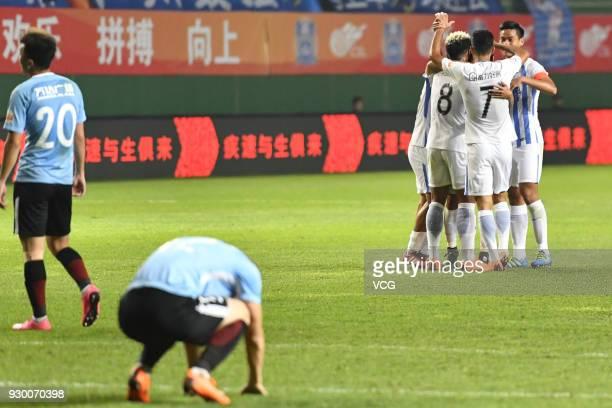Players of Guangzhou RF celebrate during the 2018 Chinese Football Association Super League second round match between Guangzhou RF and Dalian Yifang...