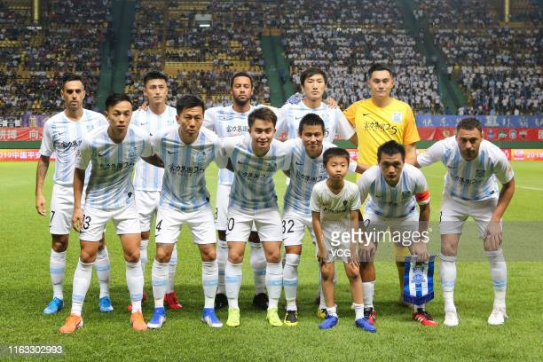 Players of Guangzhou R&F line up prior to the 2019 Chinese Football Association Super League 19th round match between Guangzhou R&F and Guangzhou...