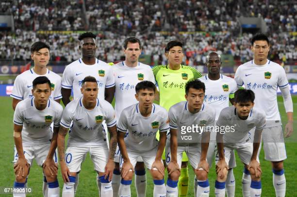 Players of Guizhou Hengfeng line up ahead of the 6th round match of China Super League between Guizhou Hengfeng and Shanghai Shenhua at Guiyang...