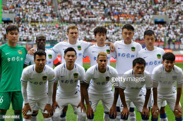 Players of Guizhou Hengfeng line up prior to the 13th round match of 2017 Chinese Football Association Super League between Guizhou Hengfeng and...