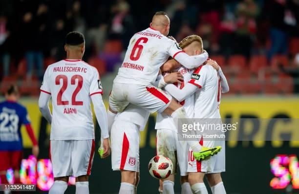 Players of Halle celebrate after their team's fourth goal during the 3 Liga match between Hallescher FC and KFC Uerdingen 05 at ErdgasSportpark on...
