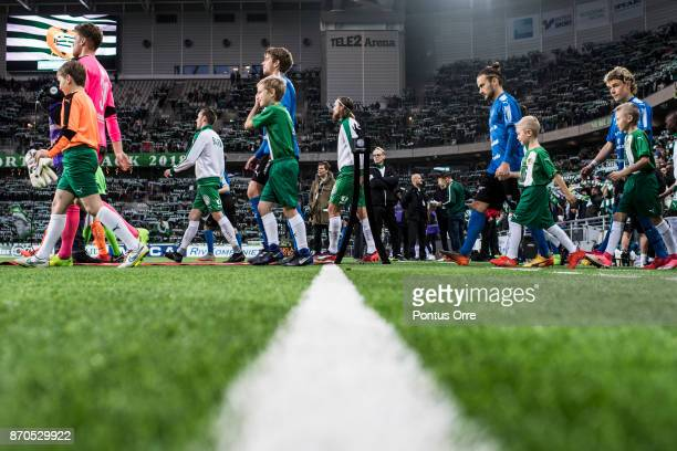 Players of Halmstad BK and of Hammarby IF enters the pitch ahead the Allsvenskan match between Hammarby IF and Halmstad BK at Tele2 Arena on November...