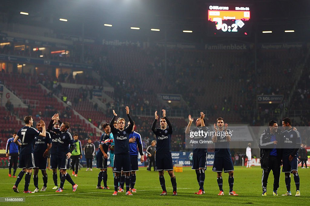 Players of Hamburg celebrate after the Bundesliga match between FC Augsburg and Hamburger SV at SGL Arena on October 26, 2012 in Augsburg, Germany.