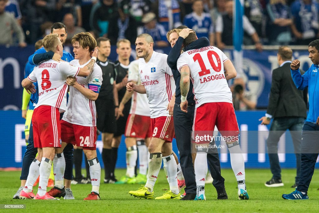 Players of Hamburg celebrate after the Bundesliga match between FC Schalke 04 and Hamburger SV at Veltins-Arena on May 13, 2017 in Gelsenkirchen, Germany.