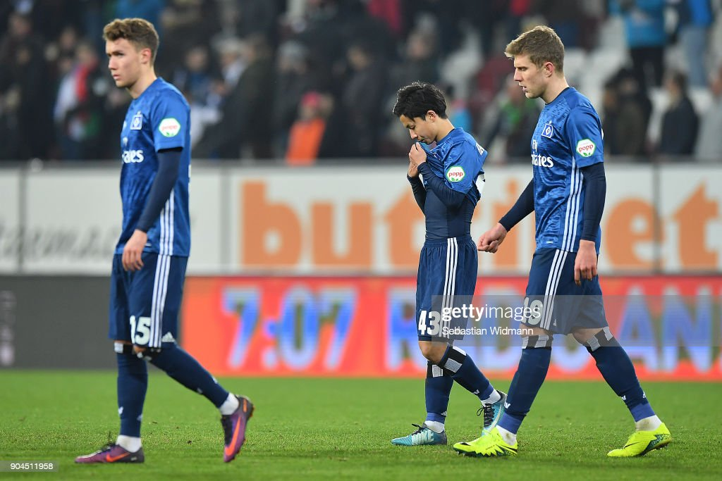 Players of Hamburg leave the pitch dejected after the Bundesliga match between FC Augsburg and Hamburger SV at WWK-Arena on January 13, 2018 in Augsburg, Germany.