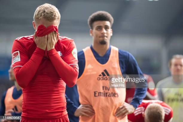 Players of Hamburg react after during the Second Bundesliga match between SC Paderborn 07 and Hamburger SV at Benteler Arena on May 12 2019 in...