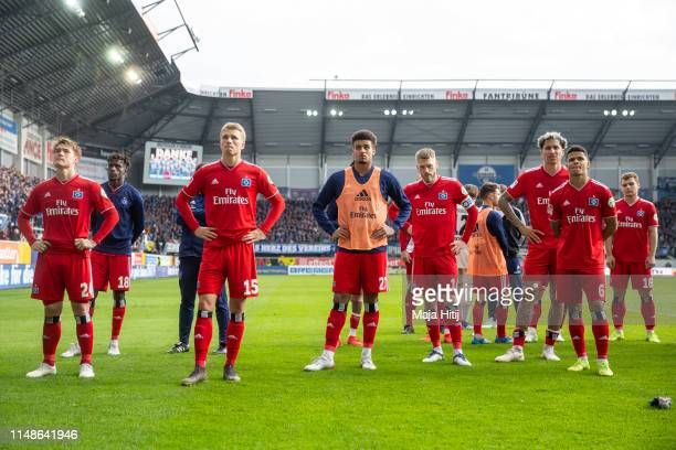 Players of Hamburg stand in front of the fans after the Second Bundesliga match between SC Paderborn 07 and Hamburger SV at Benteler Arena on May 12...