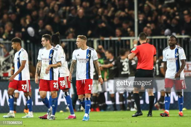 Players of Hamburger SV react after FC St. Pauli scored their second goal during the Second Bundesliga match between FC St. Pauli and Hamburger SV at...