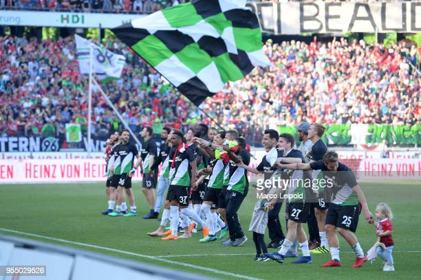 players of Hannover 96 celebrate the win after the Bundesliga game between Hannover 96 and Hertha BSC at HDI Arena on May 5 2018 in Hannover Germany