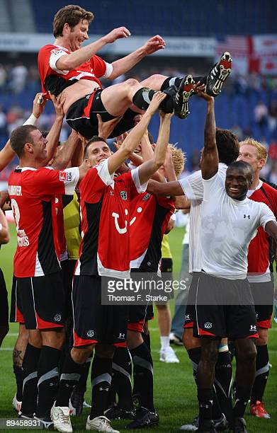 Players of Hannover celebrate Michael Tarnat after the pre season friendly match of Hannover 96 and Arsenal at the AWD Arena on July 29 2009 in...